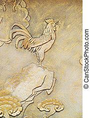 golden relief of rooster  - golden relief of rooste on rock