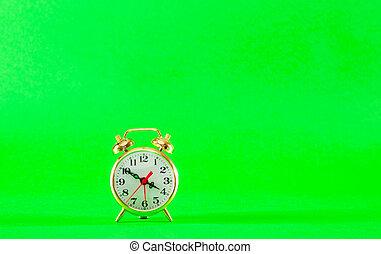 Golden retro style alarm clock