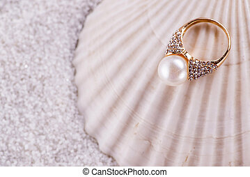 Golden ring and sea shell