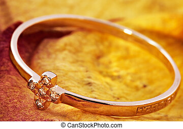 Golden ring with an ornament in the form of a cross