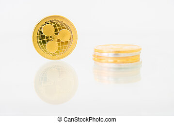 Golden Ripple coin with reflection on the table, online digital currency. Concept of block chain, market uprise