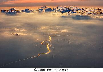 Golden river under cloud