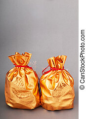 Golden sacks full of something good