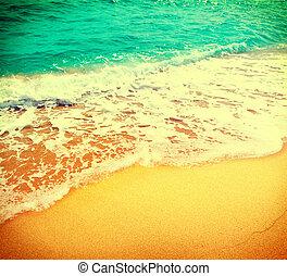 Golden sand beach with blue ocean waves