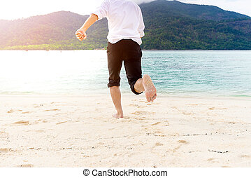 Golden sand beach with Happiness businessman running is background on beautiful sea beach at vacation Day