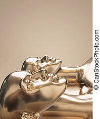 Golden scuplture of human - work of art