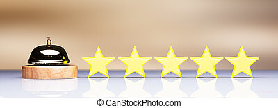 Golden Service Bell Beside Five Star Rating Icon