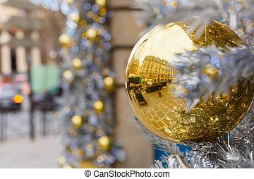 Golden shiny ball on Christmas street in Paris, France