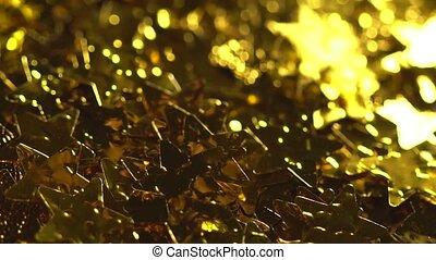 Golden shiny stars - Golden stars falling in slowmo. A lot...
