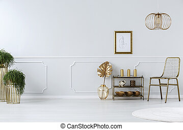 Golden sitting room interior with chair, lamp, decorations...