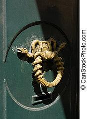 Golden snake door knocker