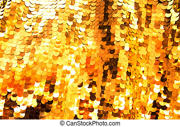 Golden sparkling sequin material as holiday background.