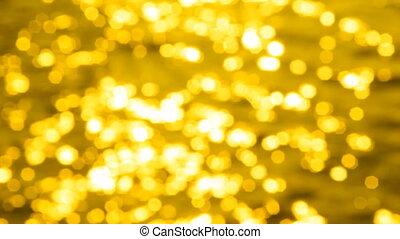 Golden sparkling water. Slo-mo.
