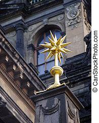 golden spiky architecture detail