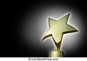 Golden star award against gradient black background
