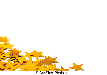 Golden star decorations spread out on white background