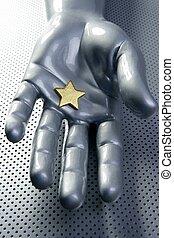 Golden star on silver futuristic hand