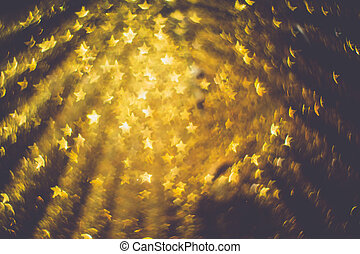 Golden Star Shaped Bokeh - Festive background with defocused...