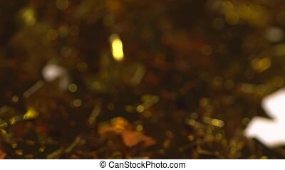 Golden stars falling in slow motion. Hollidays glitters.