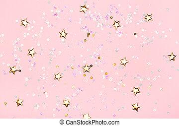 Golden stars glitter on pink background.