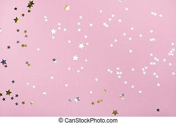Golden stars glitter on trendy pink pastel background.