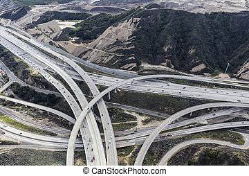 Aerial view of the Golden State 5 and Route 14 freeway interchange ramps in Los Angeles County, California.