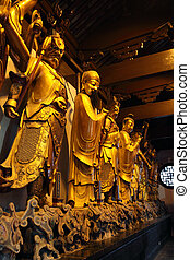 Golden statue in a buddhist temple in Shanghai, China