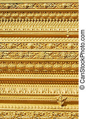 Golden - Decorative golden wall of a Thai temple