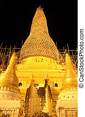 Golden stupa at night