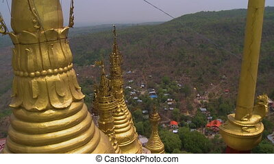 Golden stupas built close to each other - A high angle shot...