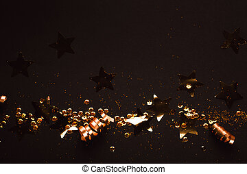 Golden stylish decoration on black background. Place for text.