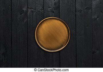 Golden stylish serving plate on black wooden table