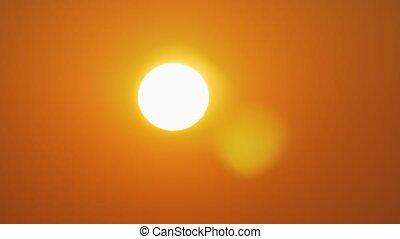 Golden sun in orange sky - Golden sunset. Sun shining in...