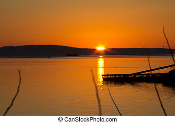 Golden sunrise reflected on the water