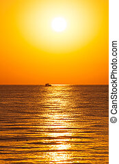 Golden sunrise with boat.