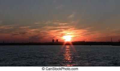Golden sunset at seaside on the beach
