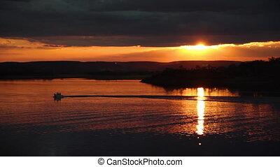 Golden sunset hits the lake