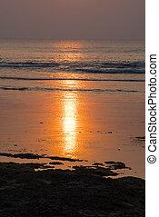 Golden sunset on summer beach coast landscape