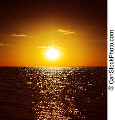 golden sunset over dark water