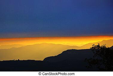 Golden sunset over mountain silhouette (Spain)