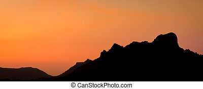 Golden sunset over the mountain