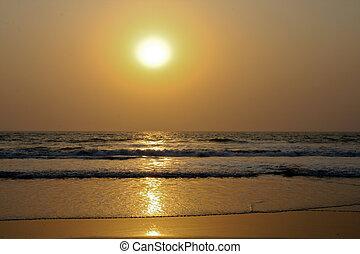 Golden sunset over the ocean waves