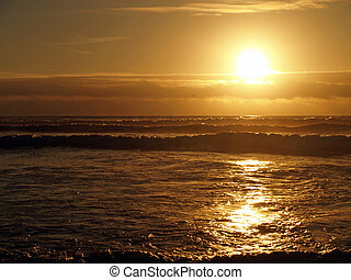 Golden Sunset Over the Ocean wth Waves in the Foreground