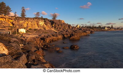 Golden sunset timelapse on Cottesloe beach, Perth, Western...