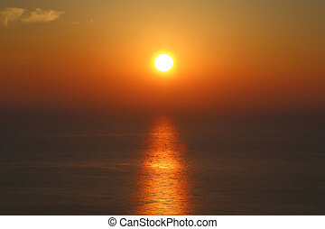 Golden sunset with reflection on the sea