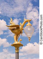 golden swan light bulb with blue sky background