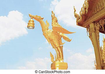 Golden swan statue