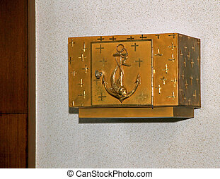 Golden Tabernacle of a Catholic Church where is placed the consecrated host during Holy Mass