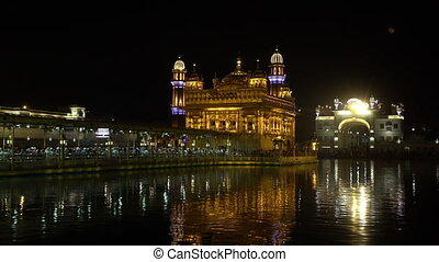 Golden Temple at Amritsar, India - Wide still night shot of...