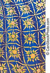 Golden Thai pattern on blue wall